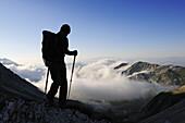 Hiker at Corno Grande at sunrise, Campo Imperatore, Gran Sasso National Park, Abruzzi, Italy, Europe