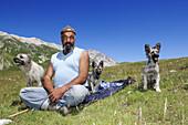 Shepherd and dogs in the mountains, Corno Grande, Campo Imperatore, Gran Sasso National Park, Abruzzi, Italy, Europe