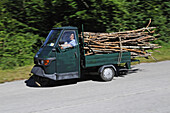 Old woman carrying wood on Vespa APE, Abruzzi, Italy, Europe