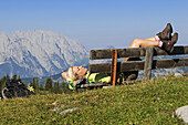 Hiker having rest at Eggenalm, Reit im Winkl, Chiemgau, Upper Bavaria, Bavaria, Germany, Europe