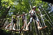 Children at high ropes course at Maserer Pass, Reit im Winkl, Chiemgau, Upper Bavaria, Bavaria, Germany, Europe