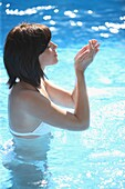 Adult, Adults, Bathe, Bathes, Bathing, Beauty, Bikini, Bikinis, Blue, Brunette, Brunettes, Carnal, Carnality, Caucasian, Caucasians, Closed eyes, Color, Color image, Colour, Contemporary, Dark-haired, Daytime, exterior, Eyes shut, Female, Fresh, Freshness