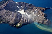 Aerial view of the steaming crater lake and outflow of the active volcano White Island
