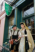Virginia, Alexandria, Old Town Alexandria, King Street, historic district, The King's Own Shoppe, business, gift shop, collectibles, shopping, man, woman, Medieval costume, sign, exterior