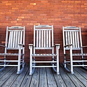 Line of old rocking chairs