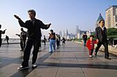 Early morning tai chi exercises on the Bund, Shanghai, China