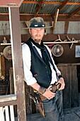 Gunman with gun and holster Tombstone Arizona