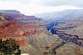 Colorado River and Grand Canyon with rain clouds National Park Arizona