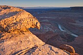View down to the Colorado River at sunset from overlook at Dead Horse Point State Park Utah