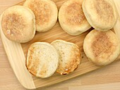 English muffins isolated on a wooden kitchen bench