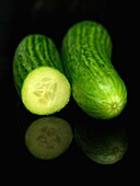 Lebanese cucumbers isolated against a black bacground