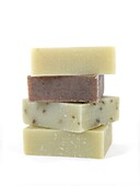Scented olive oil soaps isolated against a white background