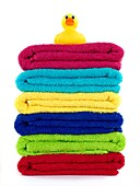 Colored bathroom towels isolated against a white background