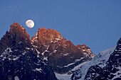 output moon in a warm evening in the hands of chamonix, alps, france