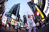 Young woman poses in Time Square, New York, USA