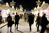 People strolling over Christmas market in the evening, Hamburg, Germany