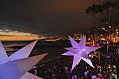 Visitors dance at sundown in the disco at Monkey Beach, Playa de las Americas,  South  Tenerife, Spain