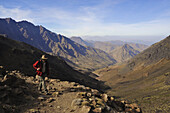 trekking in the High Atlas from Imlil, trekker, man with hat, Toubkal Area, Morocco