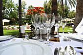 Table setting with wine glasses in the pool restaurant at Hotel Botanico,  Puerto de la Cruz, Tenerife, Canary Islands, Spain