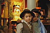Boy and girl in canrian traditional costumes in the church at Los Realejos, Romeria, Tenerife, Canary Islands, Spain