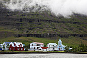 Seydisfordur, Houses And Church By The Waterside Region Of The Fjords In Northeast Iceland, Europe, Iceland