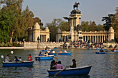 Lake With Small Boats In Front Of The Monument In Homage To Alphonse Xii, Parque Del Buen Retiro, Madrid, Spain