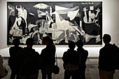 Visitors In Front Of The Guernica By Picasso, Queen Sofia Museum, Calle Santa Isabel, Atocha Neighborhood, Madrid, Spain