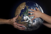 Handing Over Of The Earth From An Old Man's Hands To Those Of A Child, Illustration Of The Passing Of The Earth From One Generation To The Next, Photo Exhibition 'Fragile Earth' Presented By The Association 'L'Effet Colibri' France