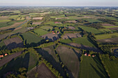 Aerial view of typical North German landscape with hedged fields and farm crops, Lower Saxony, Germany