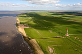 Aerial shot of lighthouse in Elbe Marshes, Elbe River, Otterndorf, Lower Saxony, Germany