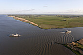 Aerial of a car ferry at the junction of the Süderelbe at Wischhafen and the Lower elbe, Lower Saxony, Germany