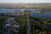 Aerial of Autobahn A7 crossing shingle ponds near Northeim, Lower Saxony, Germany
