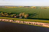 Aerial shot of fields and Stoer river near Wewelsfleth, Schleswig Holstein, Germany