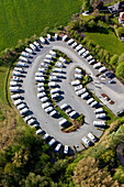 aerial of parking space for campervans, white campers, Germany