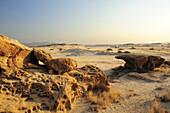 Bizarre eolian erosion at rock with view to savannah, Namib desert, Namib, Namibia