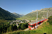 Train Matterhorn-Gotthard-Bahn near Andermatt, Canton of Uri, Switzerland