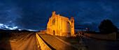 The illuminated church Santa Maria del Manzano in the evening, Castrojeriz, Province of Burgos, Old Castile, Castile-Leon, Castilla y Leon, Northern Spain, Spain, Europe