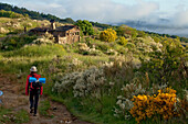 Pilgrim in idyllic landscape, Province of Leon, Old Castile, Castile-Leon, Castilla y Leon, Northern Spain, Spain, Europe