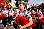 Celtic Music and Culture parade in the Interceltic Festival of Lorient. Bagpipers. Brittany. France