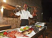 Man holding lobsters, Restaurant Gariful, Hvar Town, Hvar, Split-Dalmatia, Croatia