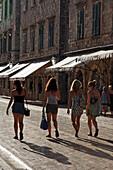 Young women strolling along Stradun, Dubrovnik, Dubrovnik-Neretva county, Dalmatia, Croatia