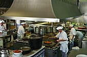 Cooks preparing paella, restaurant La Pepica, Province Valencia, Valencia, Spain