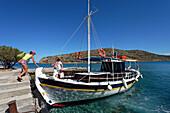 Tourists boarding a ship, Island of Spinalonga, Lasithi prefecture, Gulf of Mirabella, Crete, Greece