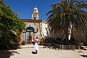 Tourists visiting Moni Toplou, Crete, Greece
