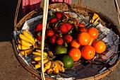 Fresh fruits in a basket, Hoi An, Annam, Vietnam