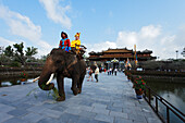 Tourist riding elefant, Citadel, Imperial City, Hue, Trung Bo, Vietnam