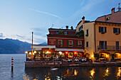 Restaurant, illuminated, Malcesine, Lake Garda, Veneto, Italy