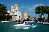 Excursion boat, Scaliger Castle, Sirmione, Lake Garda, Veneto, Italy