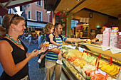 Parents with child buying ice cream, Sirmione, Lake Garda, Veneto, Italy