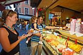 Parents with child buying ice cream, Sirmione, Lake Garda, Veneto, Italy